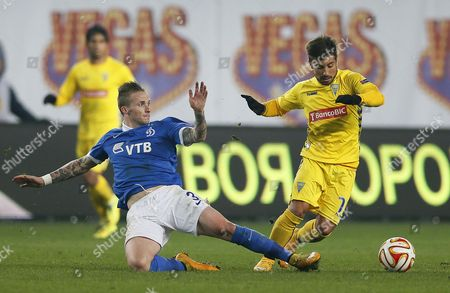 Alexander Buttner (l) of Dinamo Moscow in Action Against Toze (r) of Estoril During the Uefa Europa League Group E Soccer Match Between Dinamo Moscow and Cd Estoril in Khimki Outside Moscow Russia 06 November 2014 Russian Federation Khimki