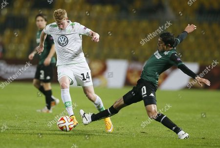 Odil Ahmedov (r) of Krasnodar in Actions Against Kevin De Bruyne of Vfl Wolfsburg During the Uefa Europa League Group H Soccer Match Between Fk Krasnodar and Vfl Wolfsburg in Krasnodar Russia 23 October 2014 Russian Federation Krasnodar