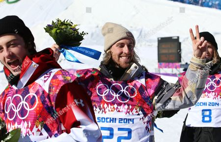 Winner Sage Kotsenburg of the Usa is Flanked by Second Placed Staale Sandbech (r) of Norway and Third Placed Mark Mcmorris (l) of Canada After the Flower Ceremony For the Men's Snowboard Slopestyle Final at Rosa Khutor Extreme Park at the Sochi 2014 Olympic Games Krasnaya Polyana Russia 08 February February 2014 Russian Federation Krasnaya Polyana