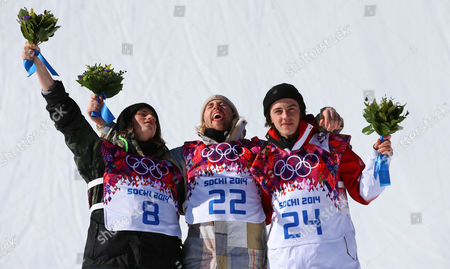 Winner Sage Kotsenburg of the Usa is Flanked by Second Placed Staale Sandbech (l) of Norway and Third Placed Mark Mcmorris of Canada During the Flower Ceremony For the Men's Snowboard Slopestyle Final at Rosa Khutor Extreme Park at the Sochi 2014 Olympic Games Krasnaya Polyana Russia 08 February February 2014 Russian Federation Krasnaya Polyana