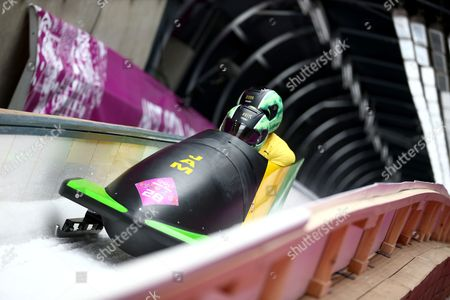 Winston Watts and Marvin Dixon of Jamaica in Action During the First Run of the Two-man Bobsleigh Competition at the Sanki Sliding Center at the Sochi 2014 Olympic Games Krasnaya Polyana Russia 16 February 2014 Russian Federation Krasnaya Polyana