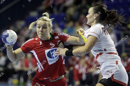 Isabel Blanco of Norway Vies For the Ball with Beatriz Fernandez of Spain During the Match Between Norway and Spain at the Women Handball World Championship in Zrenjanin Serbia 7 December 2013 Serbia and Montenegro Zrenjanin
