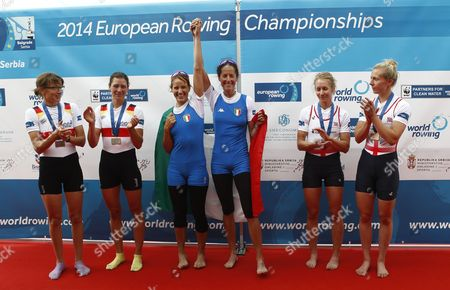 Italy's Laura Milani and Elisabetta Sancassani (c) Celebrate Their Gold Medal Next to Second Placed Germany's Lena Mueller and Anja Noske (l) and Third Placed Britain's Imogen Walsh and Katherine Copeland in the Lightweight Women's Double Sculls Final at the European Rowing Championships in Belgrade Serbia 01 June 2014 Serbia and Montenegro Belgrade