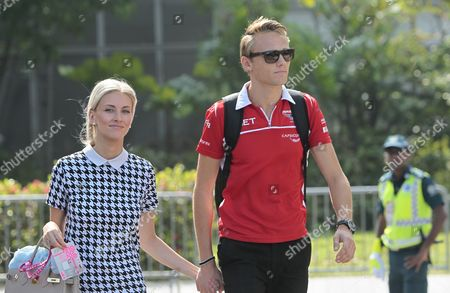 British Formula One Driver Max Chilton of Marussia F1 Team with His Girlfriend Chloe Roberts Entering the Paddock Area Before the Practice Sessions of the Singapore Grand Prix 19 September 2014 the Singapore Formula One Grand Prix Night Race Will Take Place on 21 September 2014 Singapore Singapore