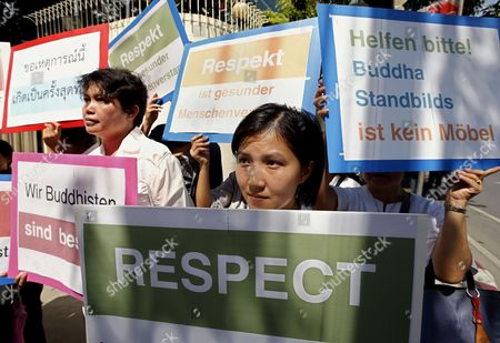 Thai Buddhist Devotees Hold Banners During a Protest Against the Art Exhibition Displayed a Disrespectful Fallen Buddha Sculpture in Front of the German Embassy in Bangkok Thailand 02 July 2013 Thai Buddhists Held a Protest Against the Outrage Over a Disrespectful Artwork of an Overturned Buddha Statue Displaying at the Viktualienmarkt Open-air Market in Munich Germany the Entitled 'Made in Dresden' and Created For the Project Series 'A Space Called Public' by Malaysian Artist Han Chong is Now Causing Debate Because Buddhists See the Sculpture As Violating a Religious Symbol Thailand Bangkok
