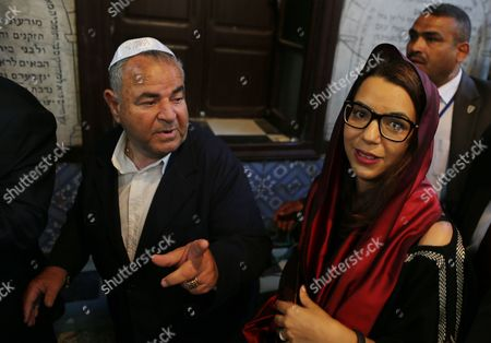 Tunisian Representative of the Jewish Community in Ghriba Perez Trabelsi (l) Speaks with Tunisian Minister of Tourism Amel Karboul (r) at the Ancient Ghriba Synagogue in Djerba Tunisia 18 May 2014 During the Annual Griba Pilgrimage That Celebrates the End of Passover Tunisia Djerba