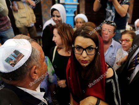 Stock Image of Tunisian Minister of Tourism Amel Karboul (c) Visits the Ancient Ghriba Synagogue in Djerba Tunisia 18 May 2014 During the Annual Griba Pilgrimage That Celebrates the End of Passover Tunisia Djerba