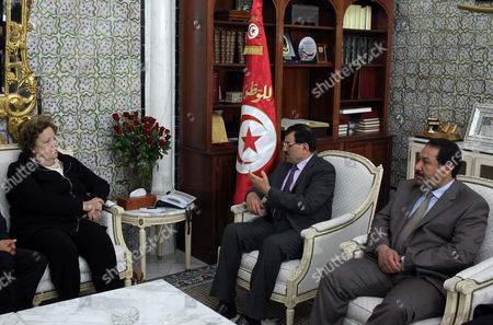 Tunisian Prime Minister Ali Larayedh (c) Meets with Italian Minister of Interior Anna Maria Cancellieri (l) in the Presence of Tunisian Minister of Interior Lotfi Ben Jeddou (r) at the Government Palace in Tunis Tunisia 24 April 2013 Cancellieri Arrived on 23 April on a Two-day Visit During Which She Will Have Talks with Tunisian Officials on Cooperation to Face Illegal Immigration Tunisia Tunis