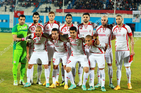 Tunisian National Soccer Team Players (front Row L-r) Houssine Ragued Ali Maaloul Hamza Mathlouthi and Wahbi Kharzi; (back Row L-r) Goalkeeper Aymen Mathlouthi Hamza Younes Fakhreddine Ben Youssef Ferjani Sassi Syam Ben Youssef Aymen Abdennour and Captain Yassine Chikhaoui Pose For Photographers Before the African Cup of Nations 2015 Qualifying Soccer Match Between Tunisia and Egypt at Mustapha Ben Jennet Stadium in Monastir Tunisia 19 November 2014 Tunisia Monastir
