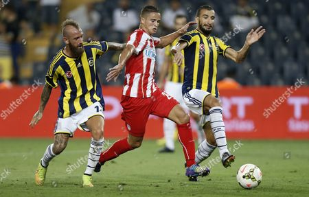 Olympiacos' Ibrahim Afellay (c) Fights For Ball Against Fenerbahce Istanbul's Mehmet Topal (r) and Raul Meireles During Their Friendly Soccer Match in Istanbul Turkey 16 August 2014 Turkey Istanbul