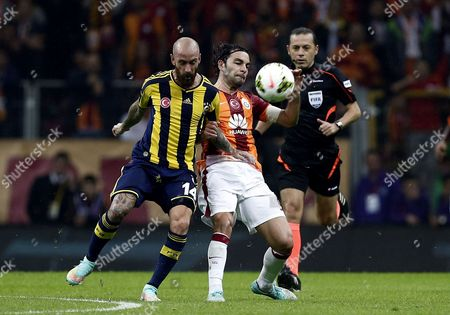 Galatasaray's Selcuk Nan (r) Fights For Ball Against Fenerbahce's Raul Meireles (l) During the Turkish Super League Soccer Match Between Galatasaray and Fenerbahce at Turk Telekom Arena in Istanbul Turkey 18 October 2014 Turkey Istanbul