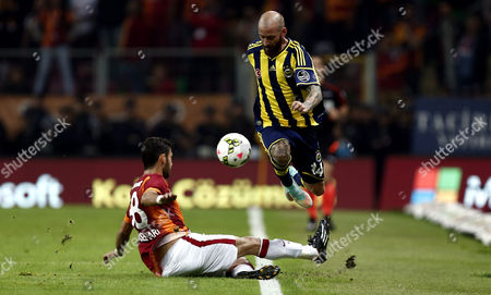 Galatasaray's Veysel Sari (l) Fights For Ball Against Fenerbahce's Raul Meireles During the Turkish Super League Soccer Match Between Galatasaray and Fenerbahce at Turk Telekom Arena in Istanbul Turkey 18 October 2014 Turkey Istanbul