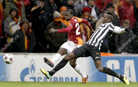 Juventus' Paul Pogba (r) Fights For Ball Against Galatasaray's Emmanuel Eboue During the Uefa Champions League Soccer Match Between Galatasaray Vs Juventus in Istanbul Turkey 10 December 2013 Turkey Istanbul