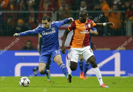 Emmanuel Eboue (r) of Galatasaray Vies For the Ball with Eden Hazard (l) of Chelsea During the Uefa Champions League Round of 16 First Leg Match Between Galatasaray and Chelsea in Istanbul Turkey 26 February 2014 Turkey Istanbul