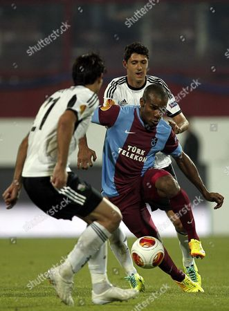 Legia Warsaw's Helio Pinto (r) in Action Against Trabzonspor's Florent Malouda (l) During the Uefa Europa League Group J Soccer Match Between Trabzonspor and Legia Warsaw at Avni Aker Stadium in Trabzon Turkey 24 October 2013 Turkey Trabzon