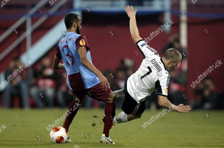 Legia Warsaw's Henrik Ojamaa (r) in Action Against Trabzonspor's Jose Bosingwa (l) During the Uefa Europa League Group J Soccer Match Between Trabzonspor and Legia Warsaw at Avni Aker Stadium in Trabzon Turkey 24 October 2013 Turkey Trabzon