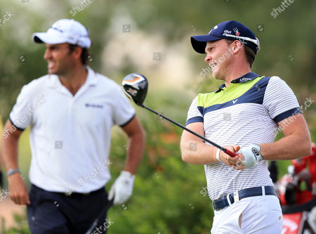 Danny Willet (r) of England is Watched by Flight Partner Edoardo Molinari (l) Italy As He Tees Off During the Second Round of the World Tour Championship Golf Tournament at the Jumeirah Golf Estates in Dubai United Arab Emirates on 21 November 2014 United Arab Emirates Dubai