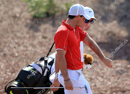 Rory Mcilroy (l) of Northern Ireland Talks to His Caddie Jp Fitzgerald During the First Round of the Dp World Tour Championship Golf Tournament at Jumeirah Golf Estates in Dubai United Arab Emirates 20 November 2014 United Arab Emirates Dubai