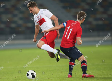 Morten Gamst Pedersen (r) Player of Norway Fights For the Ball with Partosz Bereszynski (l) Player of Poland During Their Friendly Soccer Match at Zayed Sports City Sadium in Gulf Emirate of Abu Dhabi United Arab Emirates on 18 January 2014 United Arab Emirates Abu Dhabi