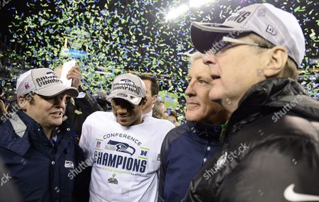 Seattle Seahawks General Manager John Schneider (l) Quarterback Russell Wilson (c-l) Coach Pete Carroll (c-r) and Owner Paul Allen (r) Celebrate After Winning the Nfc Championship Playoff Game Against the San Francisco 49ers at Centurylink Field in Seattle Washington Usa 19 January 2014 the Seattle Seahawks Will Play the Afc Champion Denver Broncos in Super Bowl Xlviii at Metlife Stadium in East Rutherford New Jersey Usa 02 February United States Seattle