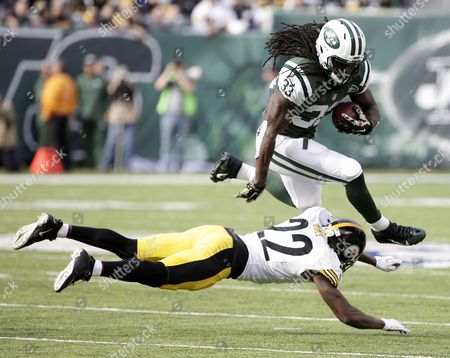 New York Jets Running Back Chris Ivory (top) Jumps Over a Defending Pittsburgh Steelers Cornerback William Gay in the First Half During the Nfl American Football Game Between the Pittsburgh Steelers and the New York Jets at Metlife Stadium in East Rutherford New Jersey Usa 09 November 2014 United States East Rutherford