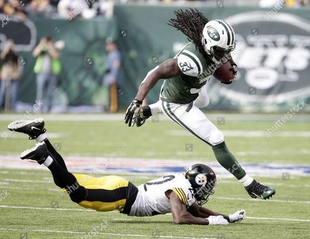 New York Jets Running Back Chris Ivory (top) Jumps Over Defending Pittsburgh Steelers Cornerback William Gay in the First Half of Their Nfl Game at Metlife Stadium in East Rutherford New Jersey Usa 09 November 2014 United States East Rutherford