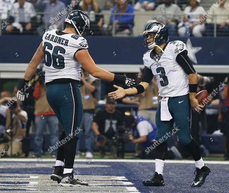 Philadelphia Eagles Player Mark Sanchez (r) Celebrates a Touchdown with Andrew Gardner (l) Against the Dallas Cowboys in the First Half of Their Game at At&t Stadium in Arlington Texas Usa 27 November 2014 United States Arlington