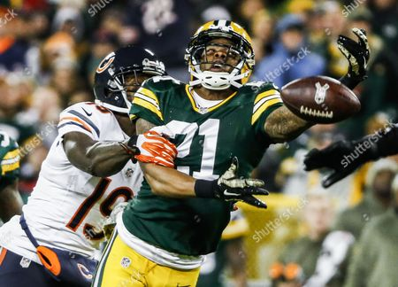Green Bay Packers Defensive Player Ha Ha Clinton-dix Fails to Intercept a Pass Intended For Chicago Bears Offensive Player Josh Morgan (l) in the First Half of Their Nfl Game at Lambeau Field in Green Bay Wisconsin Usa 09 November 2014 United States Green Bay