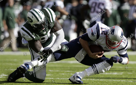 New York Jets Defensive End Muhammad Wilkerson (l) Tackles Down New England Patriots Quarterback Tom Brady in the Third Quarter During Their Nfl American Football Game at Metlife Stadium in East Rutherford New Jersey Usa 20 October 2013 United States East Rutherford