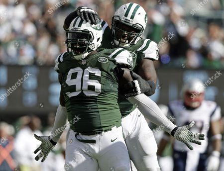 New York Jets Defensive End Muhammad Wilkerson (l) Celebrates with Teammate New York Jets Nose Tackle Damon Harrison After Wilkerson Tackled Down New England Patriots Quarterback Tom Brady (not Pictured) in the Third Quarter During Their Nfl American Football Game at Metlife Stadium in East Rutherford New Jersey Usa 20 October 2013 United States East Rutherford