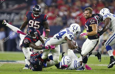 Indianapolis Colts Player Ahmad Bradshaw (c) Runs the Ball Against Houston Texans Players a J Bouye (l) and Kareem Jackson (r) in the First Half of Their Nfl Game at Reliant Stadium in Houston Texas Usa 09 October 2014 United States Houston