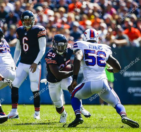 Chicago Bears Quarterback Jay Cutler (l) Watches As Chicago Bears Offensive Player Ka'deem Carey (c) Gains Four Yards on Buffalo Bills Defensive Player Keith Rivers (r) in the Second Quarter of the Nfl American Football Game Between the Buffalo Bills and the Chicago Bears at Soldier Field in Chicago Illinois Usa 07 September 2014 United States Chicago