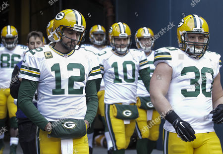 Green Bay Packers Quarterback Aaron Rodgers (left) Takes the Field with Teammates Fullback John Kuhn (right) and Quarterback Matt Flynn Before the Nfc Championship Playoffs Against the Seattle Seahawks at Centurylink Field in Seattle Washington Usa 18 January 2015 the Winner Face Afc Champions Between the Indianapolis Colts Or New England Patriots to Advance to the Super Bowl in Phoenix Arizona United States Seattle