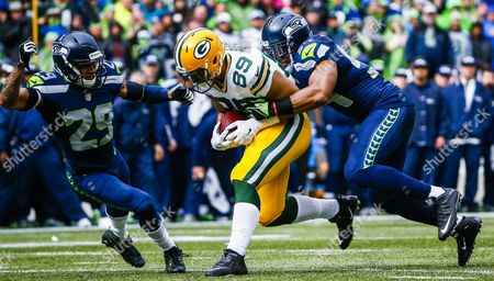 Green Bay Packers Offensive Player Richard Rodgers (c) is Tackles by Seattle Seahawks Defensive Player Bobby Wagner (r) and Seattle Seahawks Defensive Player Earl Thomas (l) During the First Half of Their Nfc Championship Playoff Game at Centurylink Field in Seattle Washington Usa 18 January 2015 the Winner Face Afc Champions Between the Indianapolis Colts Or New England Patriots to Advance to the Super Bowl in Phoenix Arizona United States Seattle