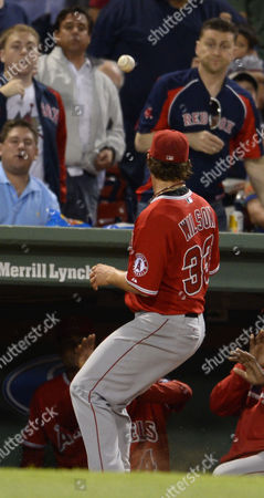 Los Angeles Angels Starting Pitcher C J Wilson Can not Reach a Pop Fly During the Third Inning Against the Boston Red Sox at Fenway Park in Boston Massachusetts Usa 18 August 2014 United States Boston