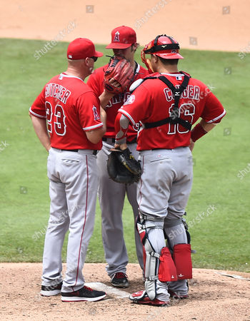 Los Angeles Angels Pitcher C J Wilson (c) Talks with Catcher Hank Conger (r) and Pitching Coach Mike Butcher (l) in the Fourth Inning of the Mlb Game Between the Los Angeles Angels and the Kansas City Royals at Kauffman Stadium in Kansas City Missouri Usa 29 June 2014 United States Kansas City