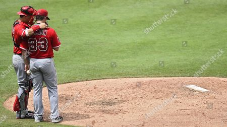 Los Angeles Angels Pitcher C J Wilson (r) Talks with Catcher Hank Conger (l) in the Fourth Inning of the Mlb Game Between the Los Angeles Angels and the Kansas City Royals at Kauffman Stadium in Kansas City Missouri Usa 29 June 2014 United States Kansas City