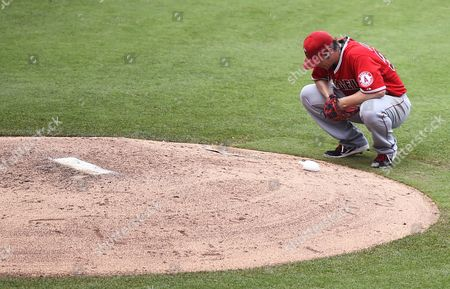 Los Angeles Angels Pitcher C J Wilson Pauses Behind the Pitchers Mound After Giving Up a Run in the Fourth Inning of the Mlb Game Between the Los Angeles Angels and the Kansas City Royals at Kauffman Stadium in Kansas City Missouri Usa 29 June 2014 United States Kansas City