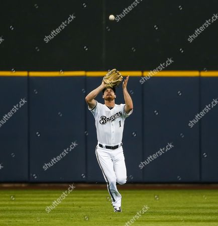 Milwaukee Brewers Outfielder Logan Schafer Runs in to Catch a Fly Ball Hit by Pittsburgh Pirates Infielder Gaby Sanchez in the Second Inning of Their Mlb Game at Miller Park in Milwaukee Wisconsin Usa 15 May 2014 United States Milwaukee