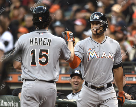 Miami Marlins Starting Pitcher Dan Haren (l) is Greeted by Miami Marlins Right Fielder Giancarlo Stanton (r) After Scoring Against the San Francisco Giants During the Second Inning of Their Mlb Game at At&t Park in San Francisco California Usa 07 May 2015 United States San Francisco