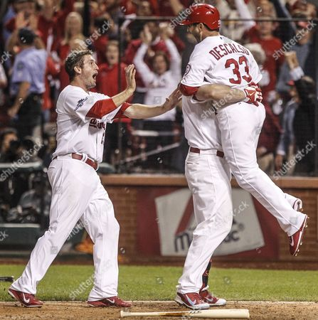 St Louis Cardinals David Freese (l) Matt Holliday (c) and Daniel Descalso (r) Celebrate Carlos Beltran's Game-winning Rbi Single During the Thirteenth Inning of Game One of the National League Championship Series at Busch Stadium in St Louis Missouri Usa 11 October 2013 United States St. Louis
