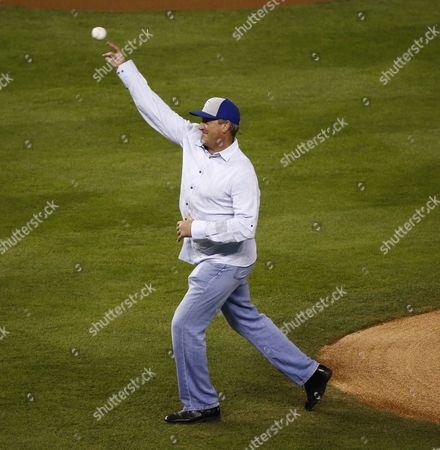 Former Kansas City Royals Pitcher Bret Saberhagen Throws out the Ceremonial First Pitch Prior to the Start of Game Seven of the World Series Between the San Francisco Giants and the Kansas City Royals at Kauffman Stadium in Kansas City Missouri Usa 29 October 2014 the World Series is Tied 3-3 Going Into the Final Game of the Annual Best-of-seven Series to Determine the Champion of Major League Baseball United States Kansas City