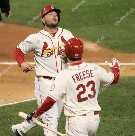 St Louis Cardinals Baserunner Matt Holliday (l) is Congratulated by On-deck Batter David Freese (r) After Scoring Against the Boston Red Sox in the Bottom of the First Inning of Game Three of the 2013 Major League Baseball World Series Between the Boston Red Sox and the St Louis Cardinals at Busch Stadium in St Louis Missouri Usa 26 October 2013 Games One Two Six and Seven Will Be Played in Boston Massachusetts and Games Three Four and Five Will Be Played in St Louis Missouri As Necessary in the Best-of-seven Series Epa/tannen Maury United States St. Louis