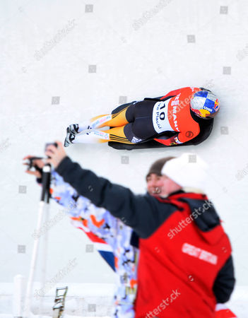 Anja Huber of Germany in Action As Fans Take a Self Portrait During the First Run of the Fibt Bobsleigh and Skeleton World Cup Women's Skeleton Competition in Lake Placid New York Usa 13 December 2013 United States Lake Placid