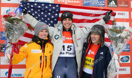 Noelle Pikus-pace of the Usa Celebrates Her Gold Medal Win Along with Silver Medalist Anja Huber of Germany (l) and Bronze Medalist Elizabeth Yarnold of Great Britain (r) Following the Fibt Bobsleigh and Skeleton World Cup Women's Skeleton Competition in Lake Placid New York Usa 13 December 2013 United States Lake Placid