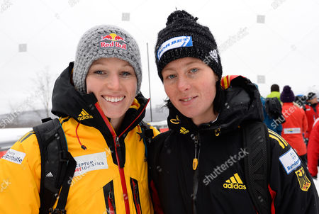 Anja Huber of Germany (l) and Team Mate Marion Thees (r) Pose Following the Fibt Bobsleigh and Skeleton World Cup Women's Skeleton Competition in Lake Placid New York Usa 15 December 2013 the World Cup Race was Changed to a Single Heat Following Problems with the Ice Conditions United States Lake Placid