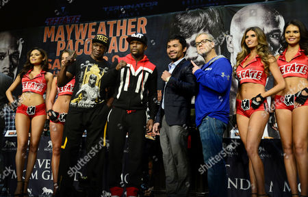 Filipino Boxer Manny Pacquiao (2r) and Us Boxer Floyd Mayweather Jr (2l) Pose with Their Trainers Floyd Mayweather Sr (l) and Freddie Roach (r) and Tecate Models Following a Press Conference at Mgm Grand Casino in Las Vegas Nevada Usa 29 April 2015 Manny Pacquiao Will Fight Floyd Mayweater Jr For the Wbc Welterweight Title Bout on 02 May in Las Vegas United States Las Vegas