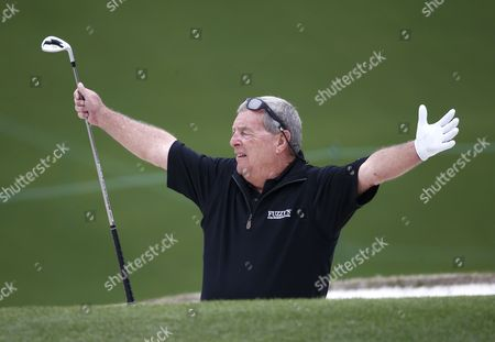 Fuzzy Zoeller of the Us Reacts As He Hits From a Bunker on the Ninth Hole As the Inaugural Drive Chip & Putt National Finals Goes on Elsewhere on the Couse at the 2014 Masters Tournament at the Augusta National Golf Club in Augusta Georgia Usa 06 April 2014 the Masters Tournament is Held 10 April Through 13 April 2014 United States Augusta