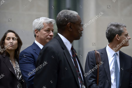 J P Morgan Chase Ceo James Dimon (2-l) Leaves the Us Deartment of Justice After a Meeting with Us Attorney General Eric Holder (not Pictured) in Washington Dc Usa 26 September 2013 the Meeting Centered on a Settlement to End Investigation of Alleged Abuses in Residential Mortgage-backed Securities United States Washington