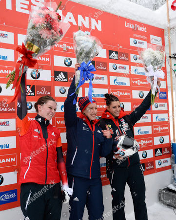 Gold Medal Winner Elizabeth Yarnold of Great Britain (c) Celebrates with Silver Medalist Elisabeth Vathje of Canada (l) and Bronze Medalist Janine Flock of Austria (r) Following the Women's Skeleton Portion of the Fibt World Cup Bobsled and Skeleton at Mt Van Hoevenberg in Lake Placid New York Usa 12 December 2014 United States Lake Placid